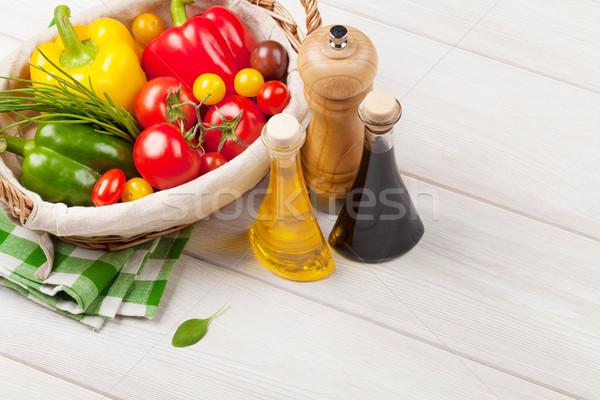 Friss zöldségek fűszerek fa asztal háttér vacsora paradicsom Stock fotó © karandaev