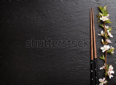 Japanese sushi chopsticks and sakura blossom Stock photo © karandaev