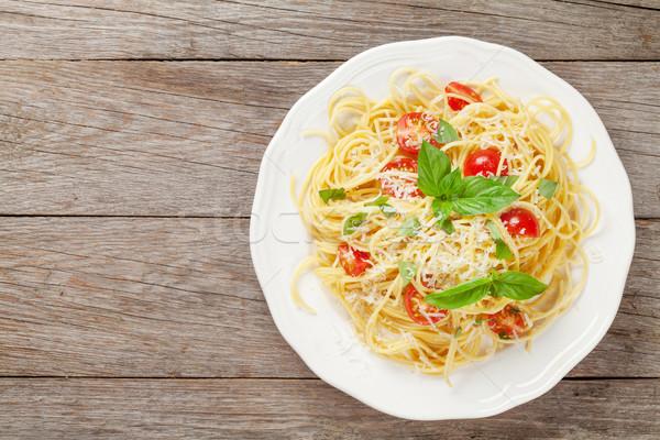 спагетти пасты помидоров базилик деревянный стол Top Сток-фото © karandaev