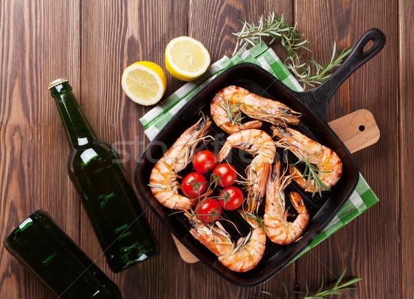 Grilled shrimps on frying pan and beer Stock photo © karandaev
