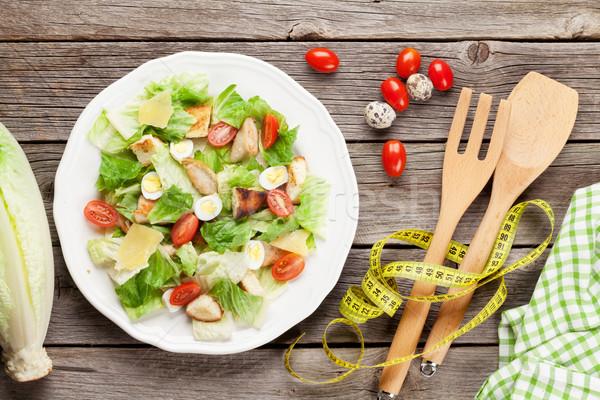 Friss egészséges étrend saláta fa asztal felső kilátás Stock fotó © karandaev