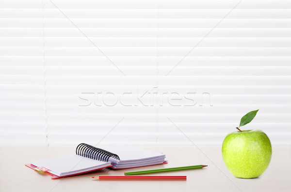 Office workplace with supplies and apple Stock photo © karandaev