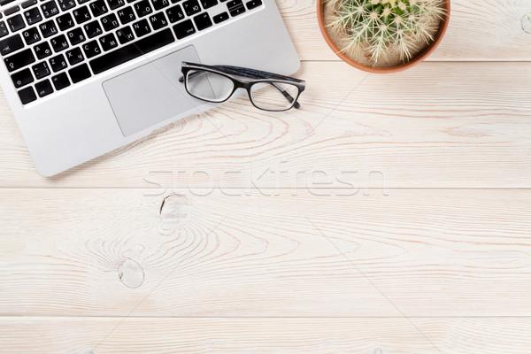 столе ноутбука кактус очки деревянный стол месте Сток-фото © karandaev