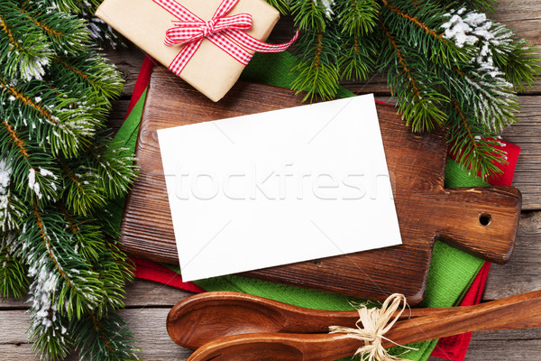Christmas greeting card over cooking table and utensils Stock photo © karandaev