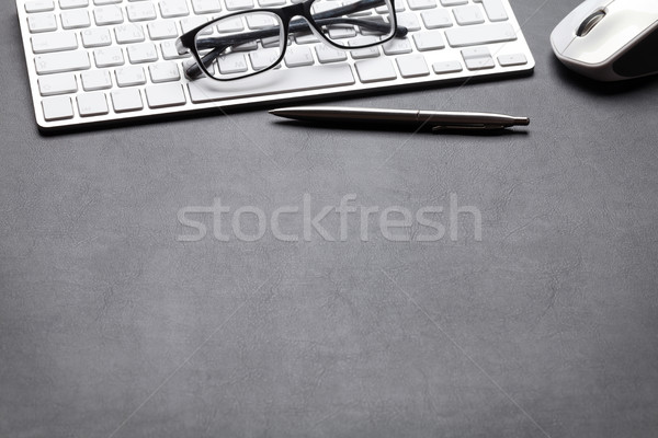 Office leather desk table with pc, glasses and pen Stock photo © karandaev