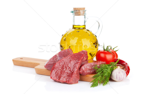 Nyers filé bifsztek fűszer vágódeszka izolált Stock fotó © karandaev