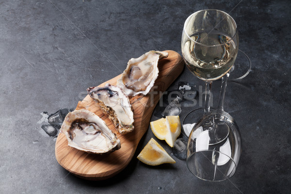 Oysters and wine Stock photo © karandaev