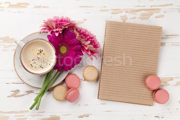 Coffee cup, macaroons and gerbera flowers Stock photo © karandaev