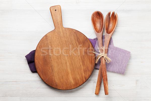 Vágódeszka fa asztal kellékek főzés háttér felső Stock fotó © karandaev