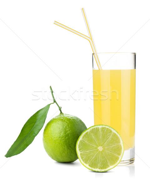 Lime juice glass with ripe limes Stock photo © karandaev