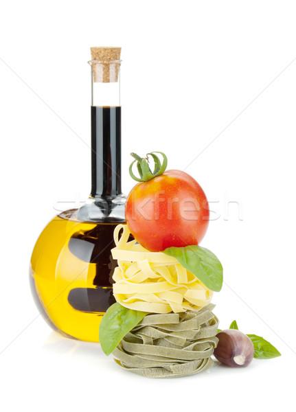 Nourriture italienne pâtes tomates huile d'olive isolé blanche Photo stock © karandaev