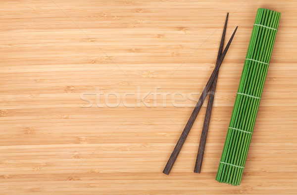 Chopsticks and bamboo mat Stock photo © karandaev