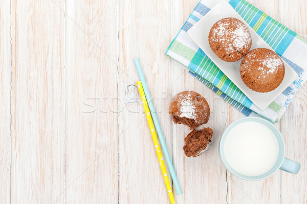 Cup of milk and cakes Stock photo © karandaev