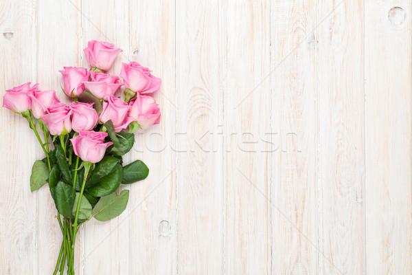 Pembe güller buket ahşap masa üst görmek Stok fotoğraf © karandaev