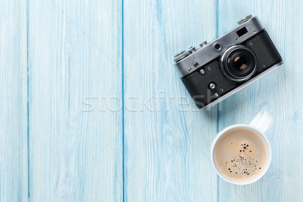 Travel camera and coffee cup on wooden table Stock photo © karandaev