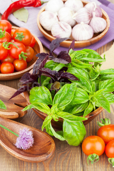 Fresh farmers tomatoes and basil Stock photo © karandaev