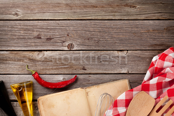 Kitchen table with recipe book and ingredients Stock photo © karandaev