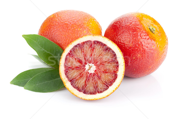 Red oranges with leafs Stock photo © karandaev