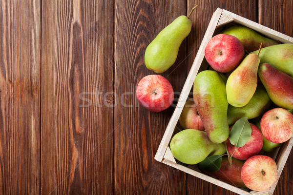 Pears and apples in wooden box on table Stock photo © karandaev