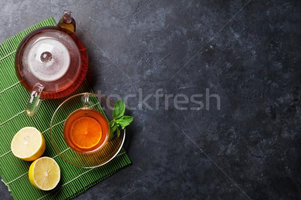 Taza de té tetera piedra mesa superior vista Foto stock © karandaev