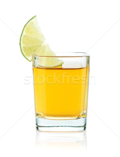 Tiro oro tequila cal rebanada aislado Foto stock © karandaev