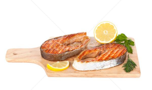 Grillowany łososia cytryny zioła deska do krojenia odizolowany Zdjęcia stock © karandaev