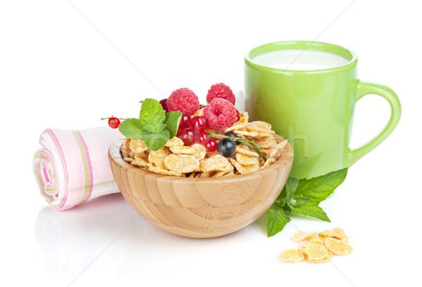 Fresh corn flakes with berries and milk Stock photo © karandaev