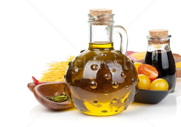 Olive oil, vinegar, tomatoes and pasta Stock photo © karandaev