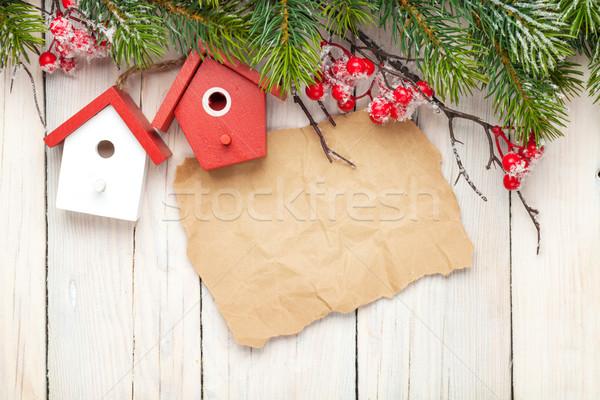 Christmas wooden background with fir tree and birdhouse decor Stock photo © karandaev