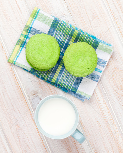 Cup of milk and macarons Stock photo © karandaev