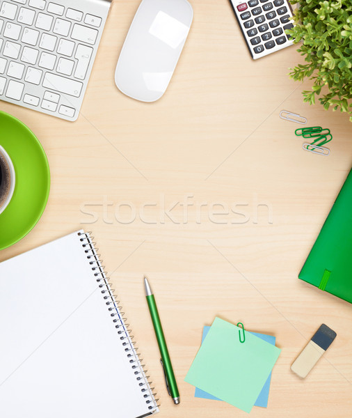 Office table with coffee cup, computer and flower Stock photo © karandaev