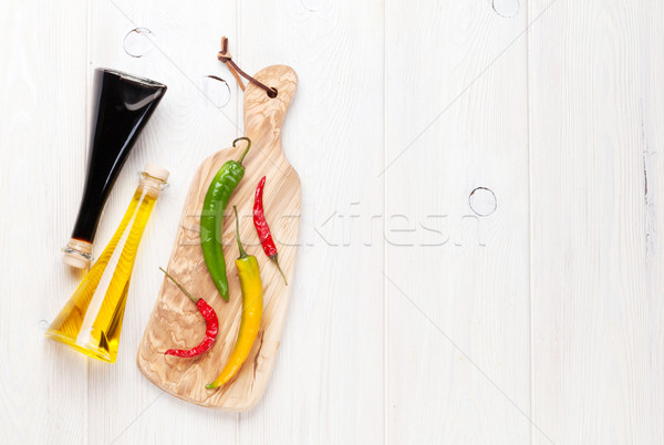 Colorful chili peppers and condiments Stock photo © karandaev