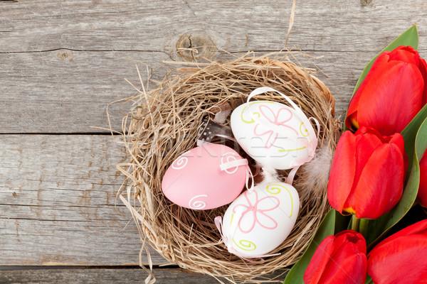 пасхальных яиц гнезда Tulip цветы деревянный стол Top Сток-фото © karandaev