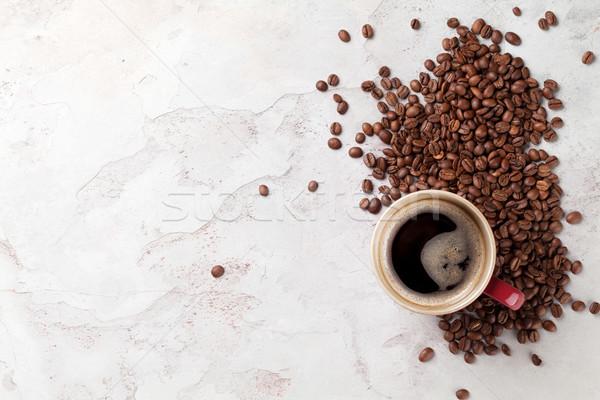 Tazza di caffè fagioli pietra tavola top view Foto d'archivio © karandaev