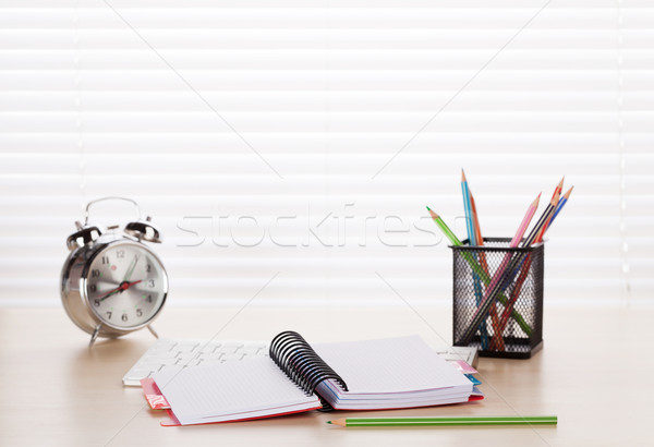 Office workplace with pc, notepad, alarm and pencils Stock photo © karandaev