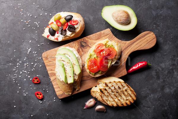 тоста Бутерброды авокадо помидоров оливками каменные Сток-фото © karandaev