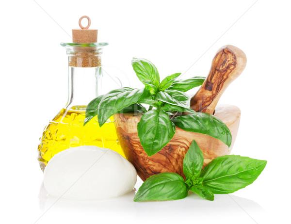 Mozzarella sajt olívaolaj bazsalikom gyógynövény levelek Stock fotó © karandaev