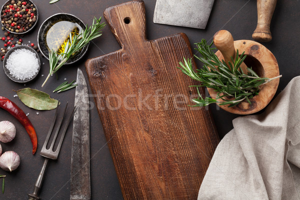 Cooking table with herbs, spices and utensils Stock photo © karandaev