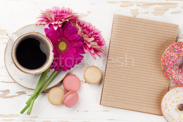 Coffee cup, donuts and gerbera flowers Stock photo © karandaev