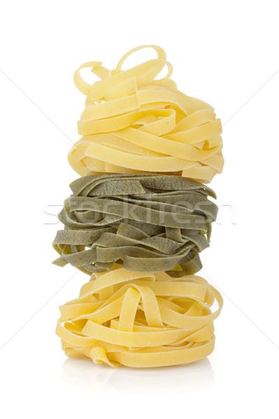Fettuccine nest colored pasta Stock photo © karandaev