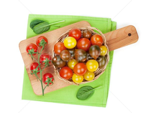 Colorido tomates cherry tabla de cortar aislado blanco Foto stock © karandaev