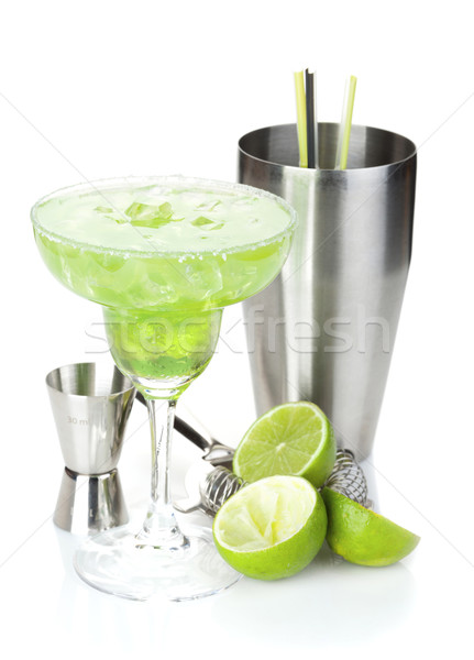 Classic margarita cocktail with salty rim, limes and drink utens Stock photo © karandaev