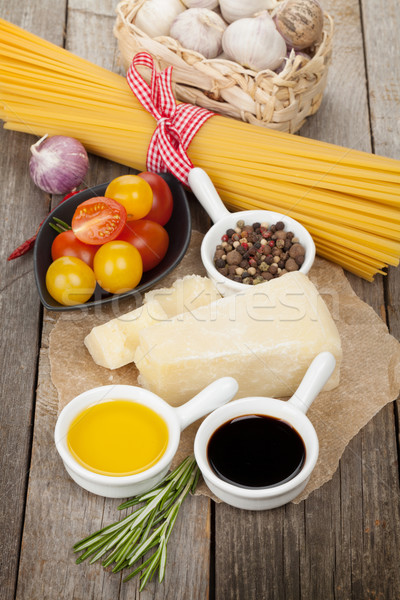 Parmesan cheese, pasta, tomatoes, vinegar, olive oil, herbs and  Stock photo © karandaev
