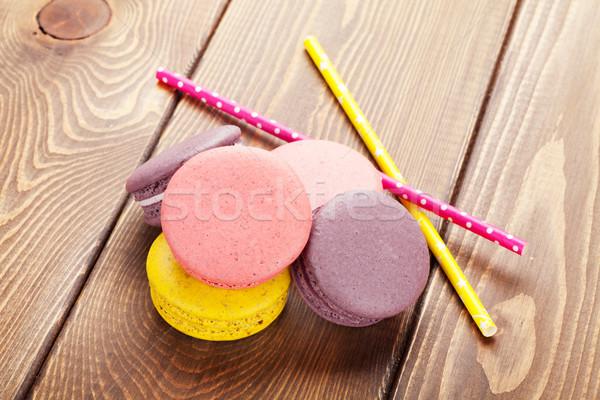 Coloré macaron cookies table en bois gâteau boire Photo stock © karandaev