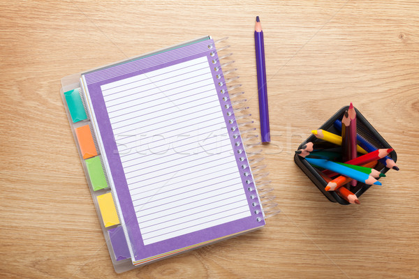Office table with blank notepad and colorful pencils Stock photo © karandaev