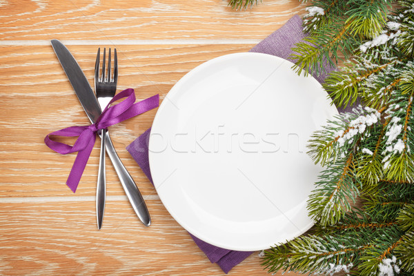 Empty plate with silverware over christmas wooden background Stock photo © karandaev