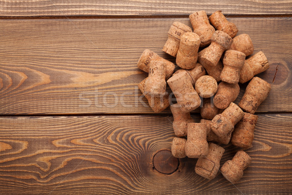 Heap of champagne corks over rustic wooden table background Stock photo © karandaev