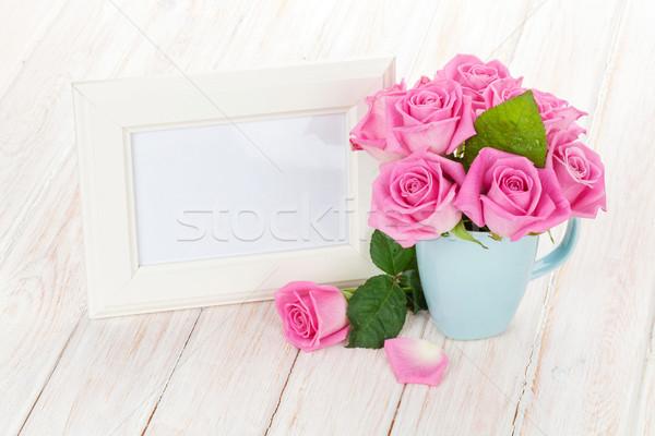 Blank photo frame and pink roses Stock photo © karandaev
