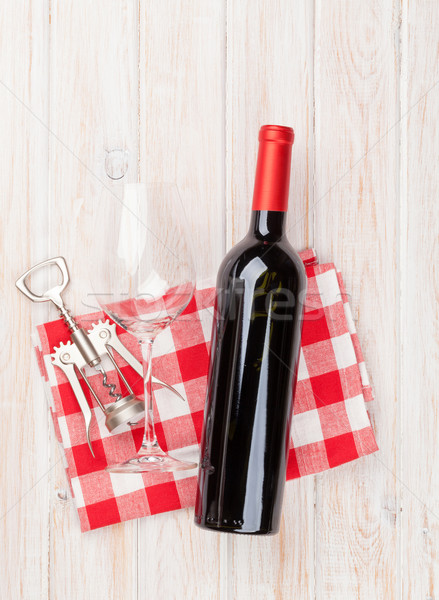 Red wine bottle, glass and corkscrew Stock photo © karandaev
