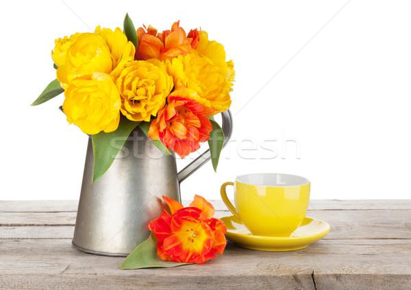 カラフル チューリップ 花束 じょうろ コーヒーカップ 木製のテーブル ストックフォト © karandaev
